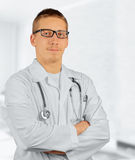 Practitioner man physician. Happy practitioner man physician in a hospital, space for text Stock Photography