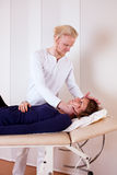 Practitioner Manipulating Patient's Neck Stock Image