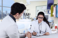 Practitioner write prescription for male patient Stock Images