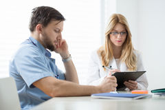 Practitioners sitting at the desk Royalty Free Stock Photography