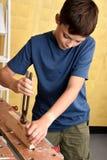 Pracująca chłopiec Obraz Stock