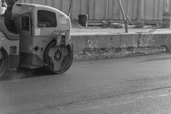 Pracująca przejażdżka na rolownika asfaltu compactor Obraz Stock