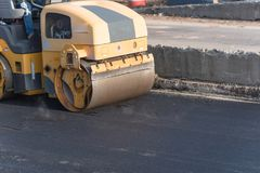 Pracująca przejażdżka na rolownika asfaltu compactor Zdjęcia Stock