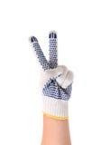 Pracująca ręka pokazuje symbolu zwycięstwo. Fotografia Royalty Free