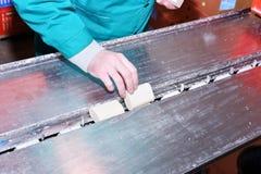 Pracująca ręka stawia baru mydło na konwejerze Obrazy Royalty Free