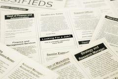 Pracy rewizja na classifieds i gazecie obraz royalty free