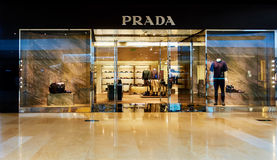 Prada fashion store shop window front. Modern luxury fashion store front with sale display window.  Fashion retail shop with logo and sign of brand Prada Royalty Free Stock Photos