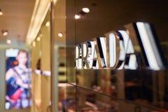 Prada sign. SINGAPORE - CIRCA SEPTEMBER, 2016: close up shot of Prada sign at Singapore Changi Airport Stock Photos