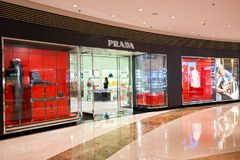 Prada store. HONG KONG - JANUARY 27, 2016: shopwindow of Prada store. Prada S.p.A. is an Italian luxury fashion house, founded in 1913 by Mario Prada Royalty Free Stock Photo