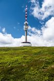 Praded hill in Jeseniky mountains in Czech republic. Praded hill with communication tower and mountain meadow in Jesenky mountains in Czech republic during nice royalty free stock image
