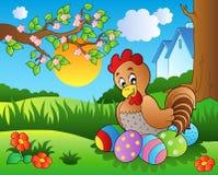 Prado con la gallina y los huevos de Pascua Imagen de archivo