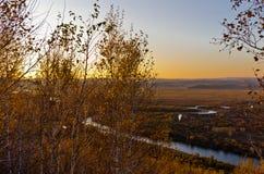 Prado y humedal en la puesta del sol Fotografía de archivo libre de regalías