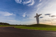 Pradopolis, Sao Paulo countryside State. Opened arms Christ statue in sunset royalty free stock photo