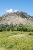 Prados às montanhas Imagens de Stock