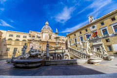 Praetoria Fountain in Palermo, Italy. The Praetoria Fountain with the dome of Santa Caterina in the background, in the square of Shame, Palermo, Italy Royalty Free Stock Image