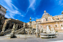 Praetoria Fountain in Palermo, Italy. The Praetoria Fountain with the dome of Santa Caterina in the background, in the square of Shame, Palermo, Italy Royalty Free Stock Images