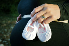 Pragnant woman. Holding small shoes Royalty Free Stock Photo