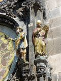 Prague Astrological Clock, Detail of Statues, Czech Republic. Two of the small colourful statues mounted on the Prague Astronomical Clock Tower, Old Town Square Stock Photography