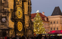 Prague astronomical clock and Christmas Tree. PRAGUE, CZECH REPUBLIC - 6TH DECEMBER 2015: Old Town Square in Prague at Christmas with the Tree and Astronomical Stock Photo