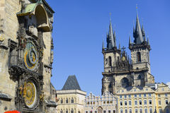 Prague astronomical clock. With church towers on the background Royalty Free Stock Photography