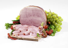 Prague baked ham. 'Prague' baked ham isolated on cutting board Stock Photography