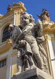 Prague - The baroque angel and facade of Loreto church - designed by Kilian Ignac 1772. Prague - Czech Republic - The baroque angel and facade of Loreto church royalty free stock image