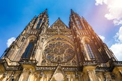 Prague, bell gothic towers and St. Vitus Cathedral. St. Vitus is a Roman Catholic cathedral in Prague, Czech Republic. Panoramic. View from the courtyard to the royalty free stock photo