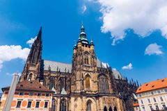 Prague, bell gothic towers and St. Vitus Cathedral. St. Vitus is a Roman Catholic cathedral in Prague, Czech Republic. Panoramic. View from the courtyard to the stock photo