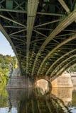 Prague bridge. Prague 'Cechuv' bridge steel construction reflected in the Vltava river royalty free stock images