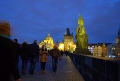 Prague bridge night sightseers Stock Photo