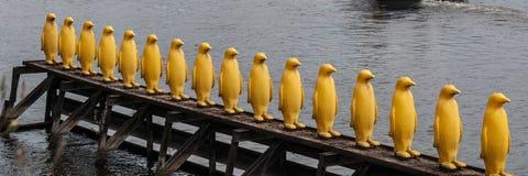 Prague, the bridge over the Vltava, a sculpture of yellow penguins. 2017-09-12 stock photography
