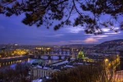 Prague bridges, Czech Republic. Twilight view over the bridges of Prague with the city lights stock photo