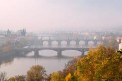 Prague bridges on foggy autumn morning. View on Prague bridges on the Vltava River, Czech Republic Stock Photos
