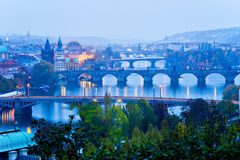 Prague bridges at night in the autumn Stock Images