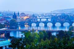 Prague bridges at night in the autumn Stock Images