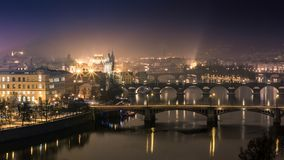 Prague bridges at night. Nice reflections in the river Royalty Free Stock Images