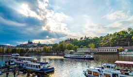 Prague buildings along Vltava river andcruise ship Royalty Free Stock Images