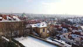 Prague is the capital of the Czech Republic. Landscape from the castle to the town during winter. Prague is the capital of the Czech Republic. Political and stock footage