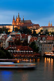 Prague Castle across the river in the evening Royalty Free Stock Image