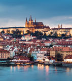 Prague Castle across Vltava river in the evening Stock Images