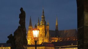 Prague Castle in background of lamp at Charles Bridge royalty free stock photography