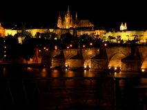 Prague castle and bridge of charles at night Royalty Free Stock Images
