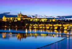 Prague castle and bridge at sunset. Stock Photos
