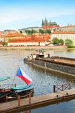 Prague castle and cathedral above Vltava river with Czech flag Royalty Free Stock Images