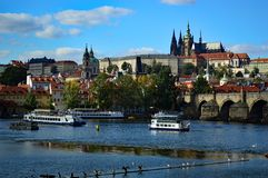 Prague Castle, Cathedral and Charles Bridge viewed from across the Vltava River. Prague Castle and st vitus cathedral viewed from across the Vltava River with stock images