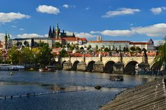 Prague Castle, Cathedral and Charles Bridge viewed from across the Vltava River. Prague Castle and st vitus cathedral viewed from across the Vltava River with royalty free stock images