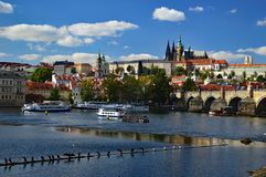 Prague Castle, Cathedral and Charles Bridge viewed from across the Vltava River. Prague Castle and st vitus cathedral viewed from across the Vltava River with royalty free stock photography