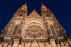 Prague Castle Cathedral Saint St Vitus front facade entry gate spire rosette by night Royalty Free Stock Photo