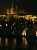 Prague castle with Charles bridge. Prague castle at night with Charles bridge in the foreground Stock Image