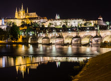 Prague Castle and Charles Bridge, Czech Republic. Prague Castle and Charles Bridge at night - view from Smetanovo nabrezi Stock Images